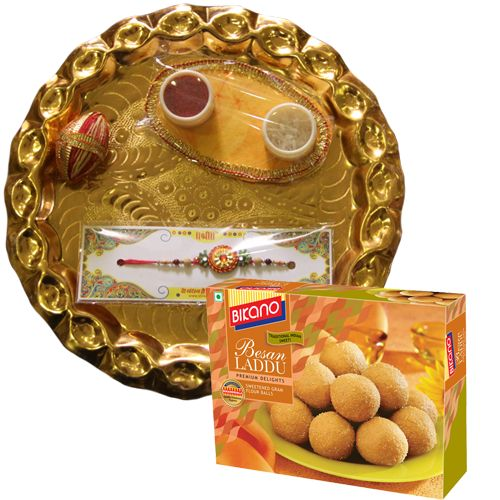 Buy online Golden thali rakhi Pack :- Pooja Thali, 1 Rakhi, Roli & Chawal , Besan laddu  Send this beautiful Rakhi hamper to your dearest Brother. Pack Includes golden plated pooja thali, stone rakhi, roli, chawal for tika and completed with branded besan laddu pack. https://www.zorataa.com/golden-thali-rakhi-pack