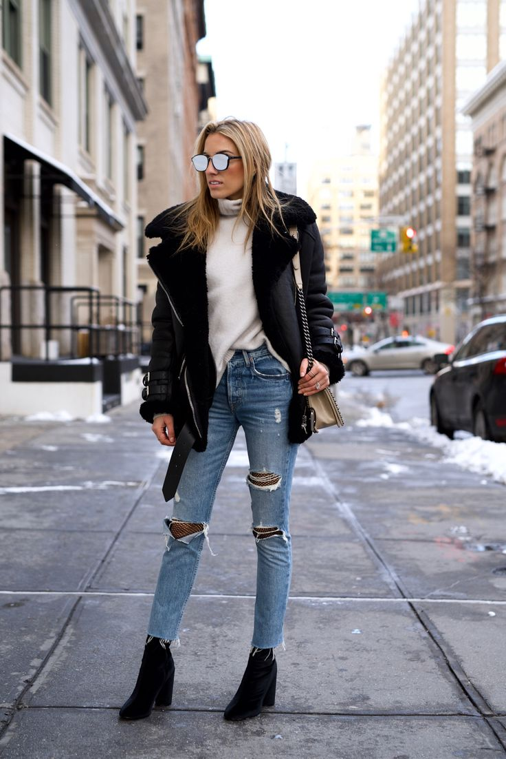 Stunning us in this Shearling coat, Lisa D Cahue demonstrates exactly how to wear this year's winter trends! Pair distressed denim with a turtleneck and heeled boots to steal this gorgeous seasonal look.  Jeans: Grlfrnd, Fishnets: Topshop, Coat: Acne Studios, Sweater: J Brand, Boots: Public Desire.