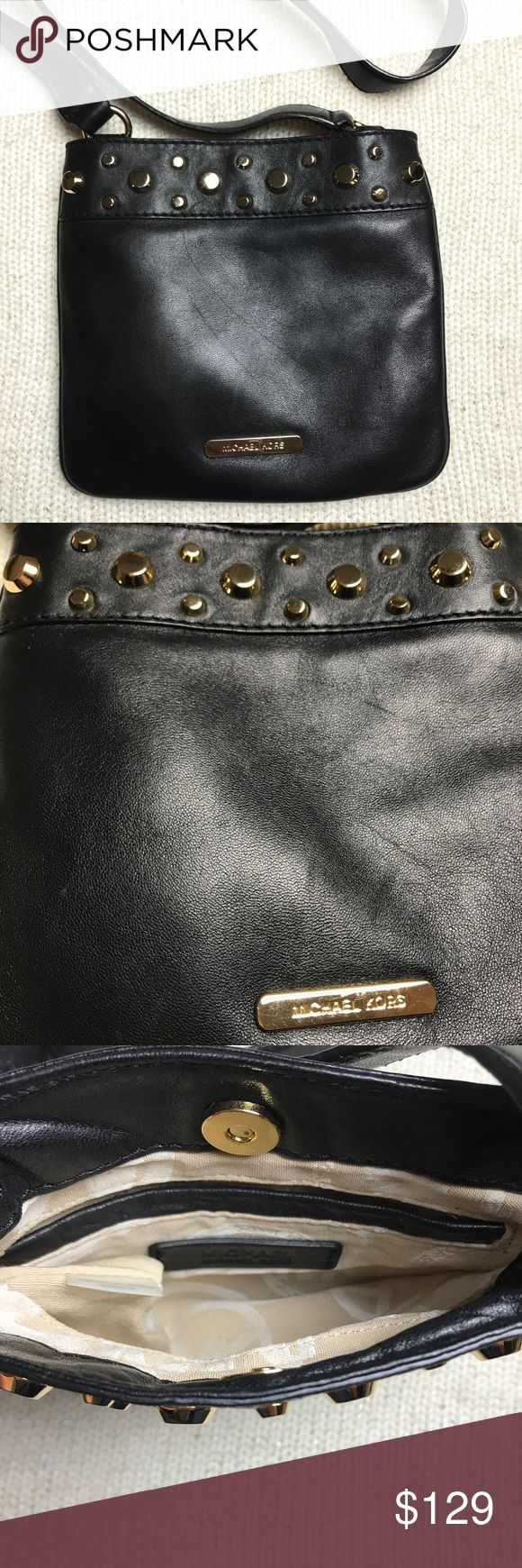 Michael Kors Black Leather Crossbody Bag Michael Kors Black Leather Crossbody Bag. Excellent condition besides the one slight mark as shown in the picture in front of bag.  Not noticeable until you shine a bright light. Michael Kors Bags Crossbody Bags