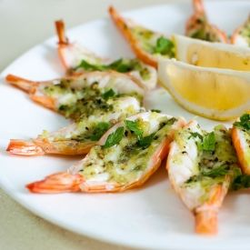 Shrimps are butterflied and baked in a garlic-parsley butter condiment - an easy appetizer to start the dinner!