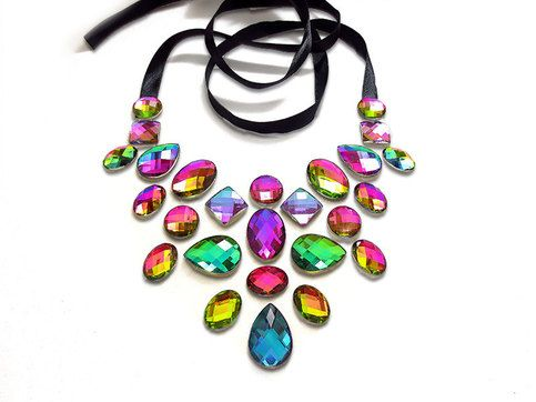 These rare and hard to find vitrai (rainbow) rhinestones shimmer in a variety of bright and bold colors! Some of the stones shine pink, green, and yellow, while others look blue, but blend into green and purple. The resulting necklace is incredibly eye-catching an changes color at every angle! Th...