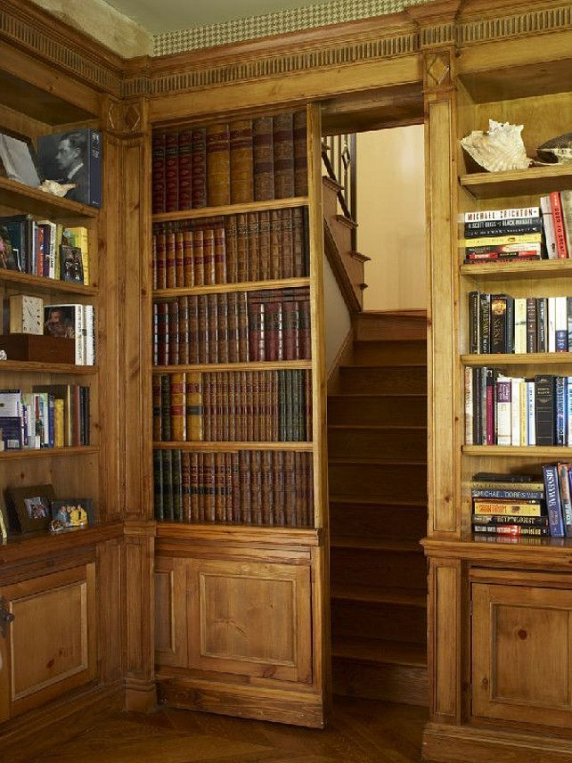 A hidden staircase behind a secret door: every home library should have one of these! I would do it with real books on the door, though.