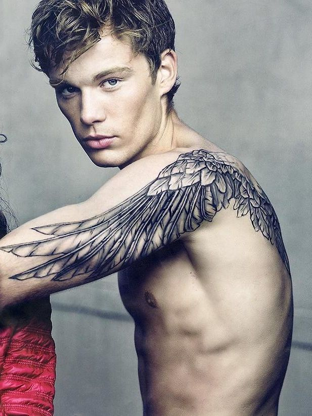 Like the idea of feathers/wings continuing down arms... Too bad I have stretch marks on my arms :/