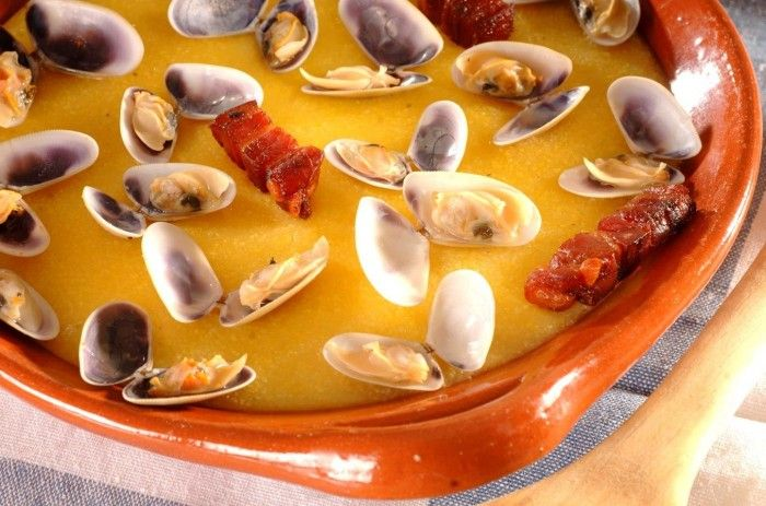 Xarém com conquilhas   Traditional dish from the city of Olhão, 'Xarém' is made with corn flour which can be cooked or served with either fish, shellfish or fresh or cured meats. 'Xarém com Conquilhas' is one of the most popular varieties of this dish.
