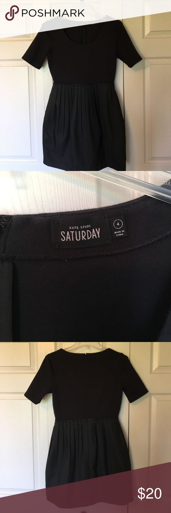 Kate Spade Saturday Black Tulip dress Kate Spade Saturday black tulip dress. Size four. Scoop neck and zippered back. Pockets in the skirt. Top part is a knit. Skirt is lined woven polyester. Worn and washed a couple of times, with some wear and fading around the neckline. See last picture. kate spade Dresses Mini