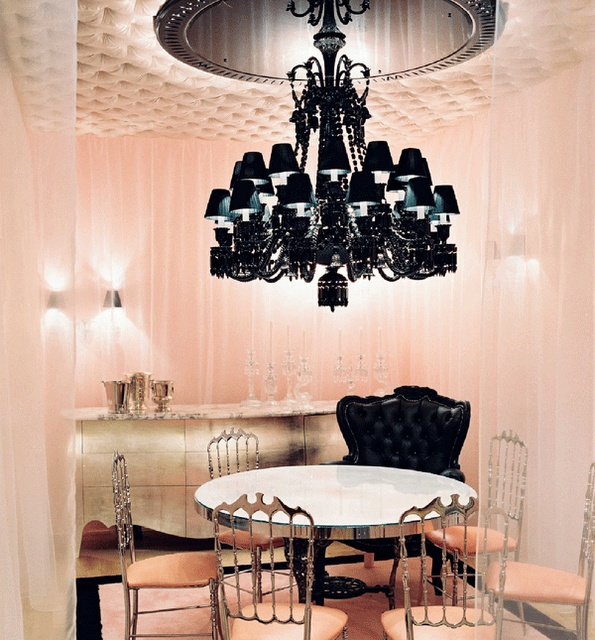 Phillipe Starck. All that pink and silver cutesy stuff not my style but that chandelier? wow!