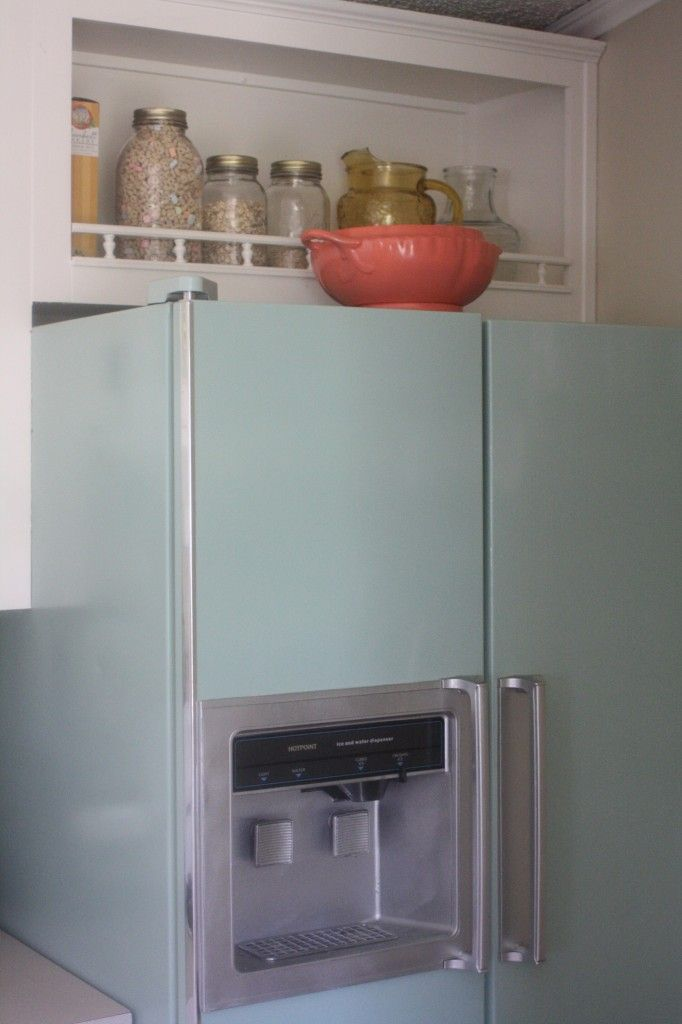 Give your kitchen a fun retro look by painting your FRIDGE!!  With spray paint!  It's been holding up really well!