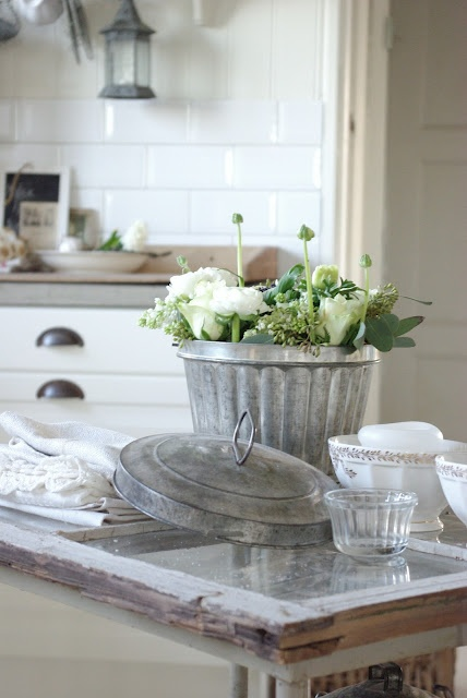 vintage kitchen with a rustic bucket full with fresh vegetables from the garden :)
