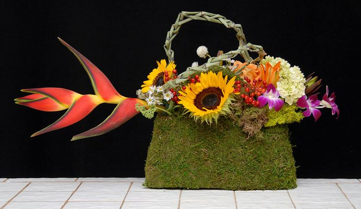 https://flic.kr/p/yafpyA | Tropical Fish Purse — The Rittners School of Floral Design, Boston | Floral designers today are incorporating fashion accessories, such as shoes and purses, into their floral art. These are things you can order from your local florist. They work very well for parties, showers, celebrating an accomplishment, milestones, birthdays, ladies luncheons and brunches and more.  — Photo Courtesy The Rittners School of Floral Design, Boston, www.floralschool.com/