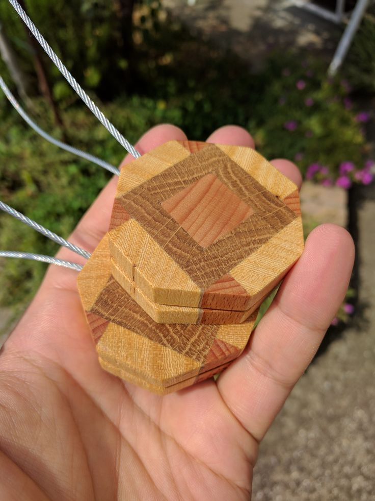 1. Glue up some beech, oak, and linden boards. 2. Cut slices, make octagons, drill holes. 3. Magic. 4. Ta-dah! Magnetic curtain tie backs!
