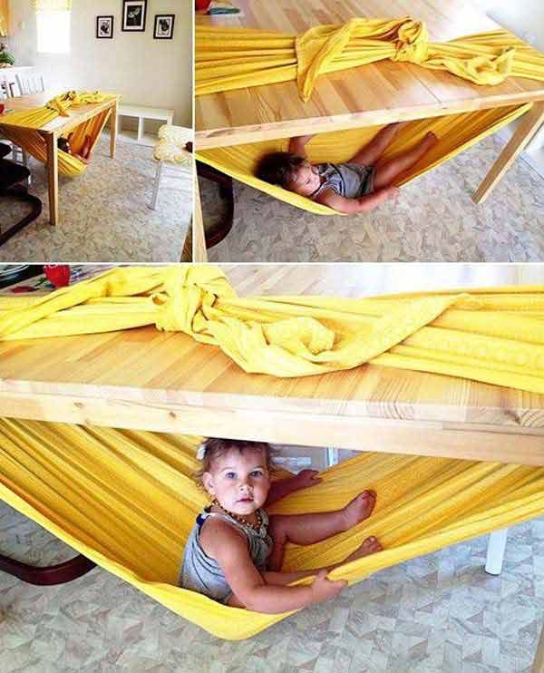 Make a hammock for your kid under a table.