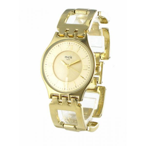 http://unemontretendance.com/876-montre-design-utraplate-doree-sur-bracelet-dore-mck.html