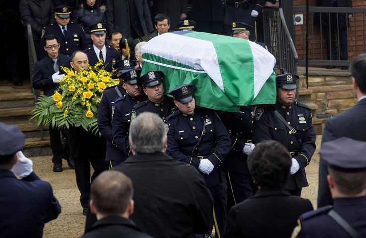 Officers carry the casket of Police Officer Wenjian Liu from a funeral service at Aievoli Funeral Home in the Dyker Heights neighborhood on Jan. 4, 2015 in Brooklyn, New York City.