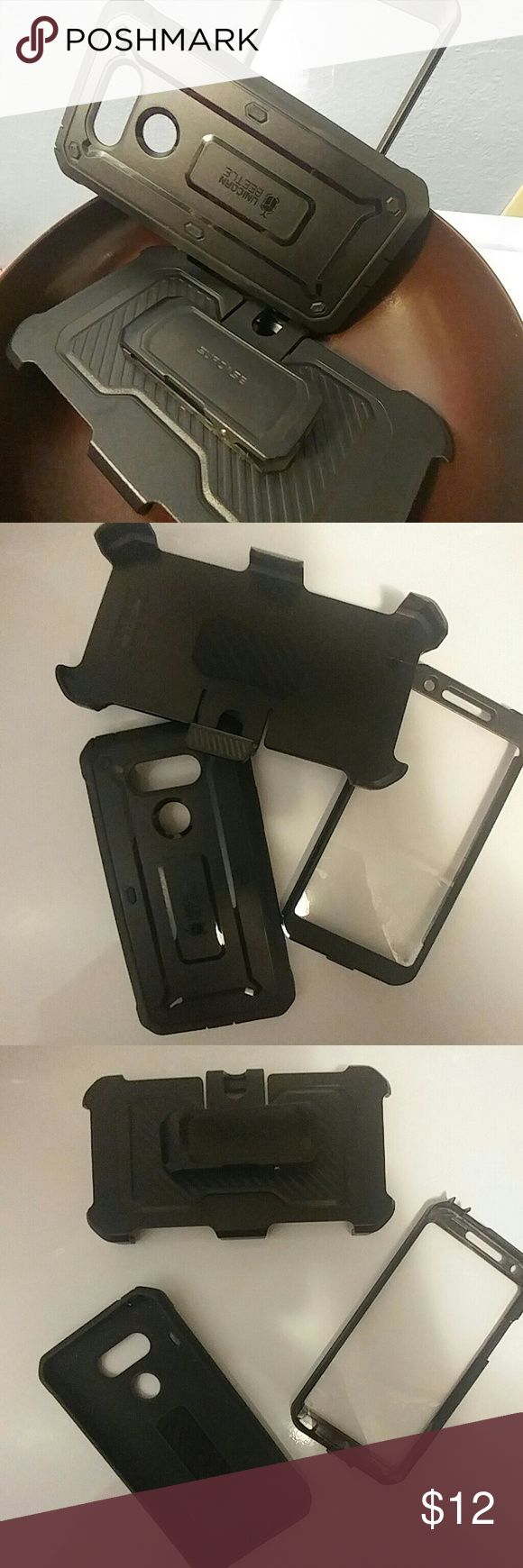 🐝Cell phone case/clip Black Unicorn Beetle (supcase) designed by Brillotech Inc. for LG G5. Lightly used. Has an actual phone case then a seperate clip case to attatch your phone and easily clip it in your purse for an eaay find😃Great condition! unicorn beetle sup case Accessories Phone Cases