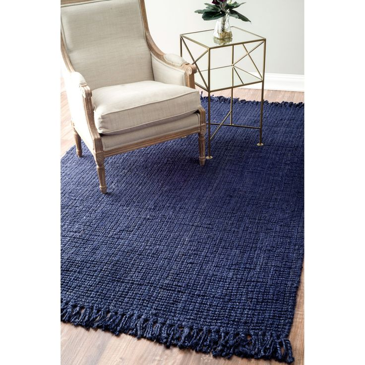 This rug is meticulously crafted by artisan rug makers with sustainably harvested jute, a fast-growing natural fiber. The fibers have a golden and silky shine and is truly an eco-friendly floor covering.