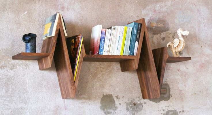 This shelf has the shape of a heartbeat and well... It does bring your living room to life! Made out of American Walnut in Amsterdam.