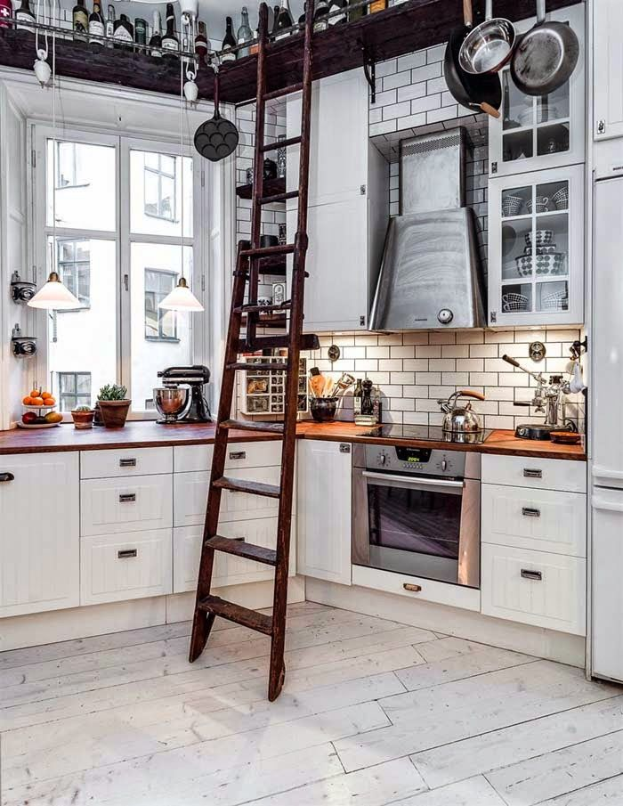 A Cozy Scandinavian Home always loved a library ladder. beautiful kitchen, makes me still want wood counters- at least in one area of kitchen