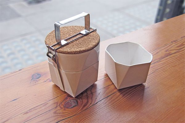 Handcrafted in durable thin-walled ceramic, this is a lunch kit of two stackable bowls and a cork lid that doubles as a plate.