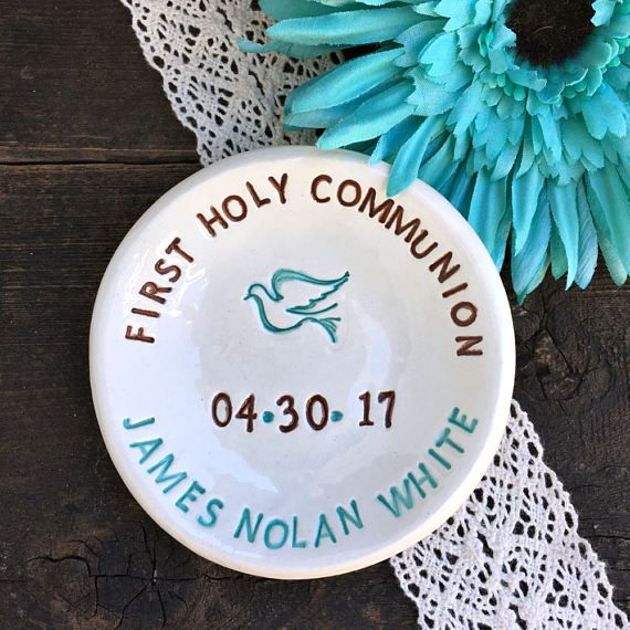 Handcrafted Personalized First Communion Keepsake Favor - Measures -3.5 in diameter featuring First Holy Communion text (can be shortened to First Communion) and personalized with the childs name and the date (xx.xx.xx) of the blessed event. Shown here in caribbean blue and dark brown