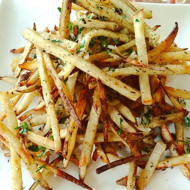 Now this is how I do french fries.. oven baked with parmigiano and parsley. . Just perfect for this crazy weather. We are all digging in while we watch the snow falling on tv, hahaha,