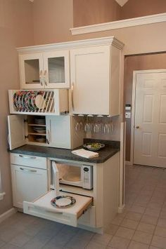 compact kitchen.  perfect for tiny homes and small hideaways. LOVE the pull out under microwave.