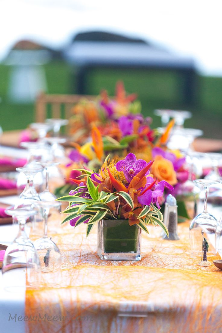 Sisal Fiber Runner adds an organic element to this vibrant tropical table