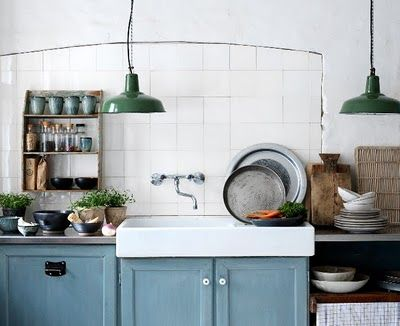 *sink & faucet. *lights. Note how the tile fills in old archway or window hinting at the evolution of the kitchen.