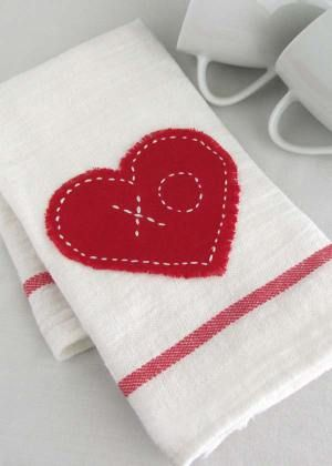 """Saying """"I love you!"""" doesn't have to cost a bundle this Valentine's Day. Impress your guests with these adorable Valentine Tea Towels {Pottery Barn inspired} for only $0.79! Read the easy tutorial with free printable pattern at BrenDid.com. The easy craft uses premade flour sack tea towels and iron-on adhesive appliqué. The best part, at under $1 each you can afford to spread the Valentine love around the whole neighborhood! - See more at: http://brendid.com/pb-inspired-valentine-tea-towels/"""