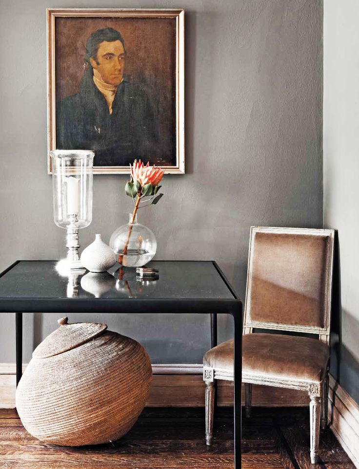 The Most Sophisticated Studio Apartment You've Ever Seen// small dining table, elegant styling, portraiture, Louis XVI chair