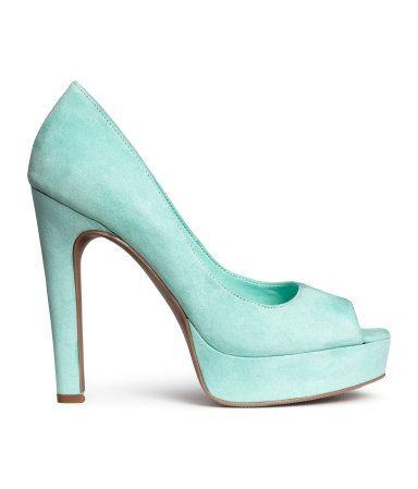 Peep-toe platform pumps with rubber soles. Front platform height 1 1/2 in., heel height 5 1/4 in.