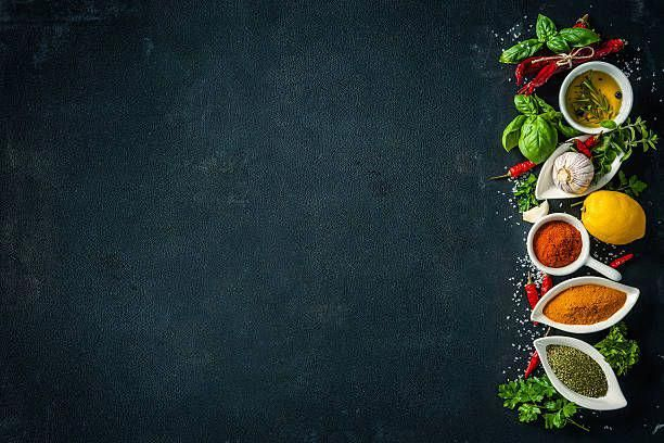 Herbs And Spices Over Black Stone Background Food Poster Design