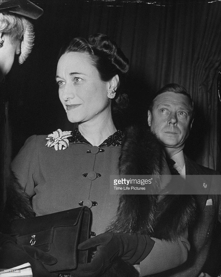 The Duke of Winsdor (1894 - 1972) marries Wallis Warfield Simpson (1896 - 1986) at the Chateau de Conde, France. Description from gettyimages.com. I searched for this on bing.com/images