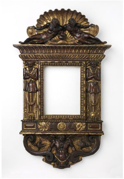 Carved and partially water gilded tabernacle frame with pediment of two reclining figures set within a shell.