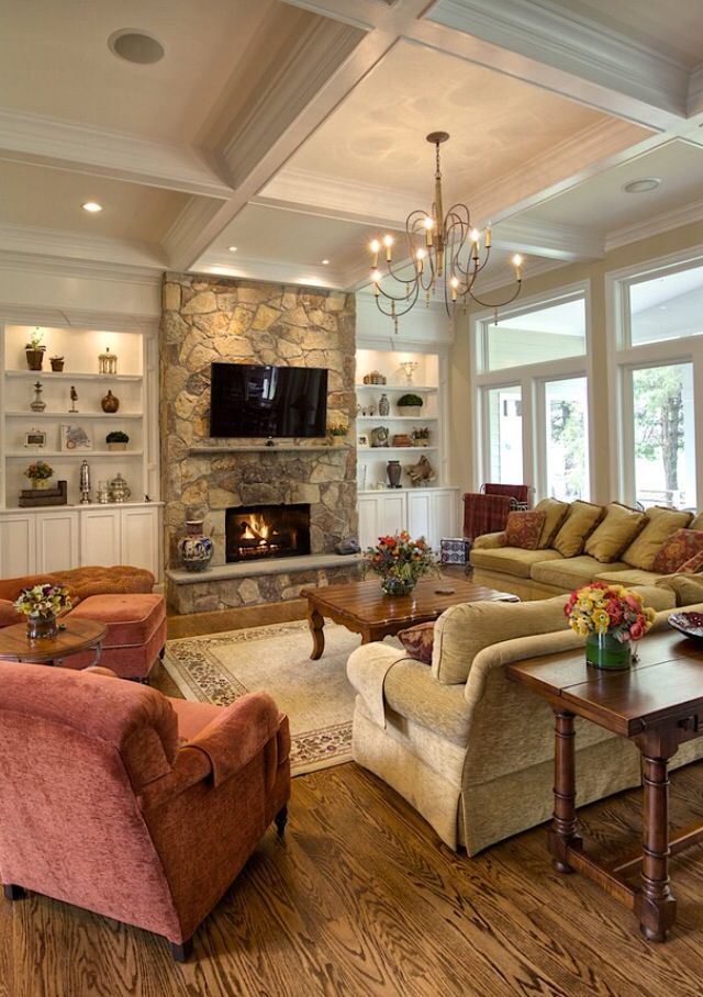 The stone area around the the TV with the fireplace is what I want to incorporate with my idea for our den either side of that will be a rich cherry wood custom library and the ceiling will be quite similar as well. Got this pic from my Houzz app