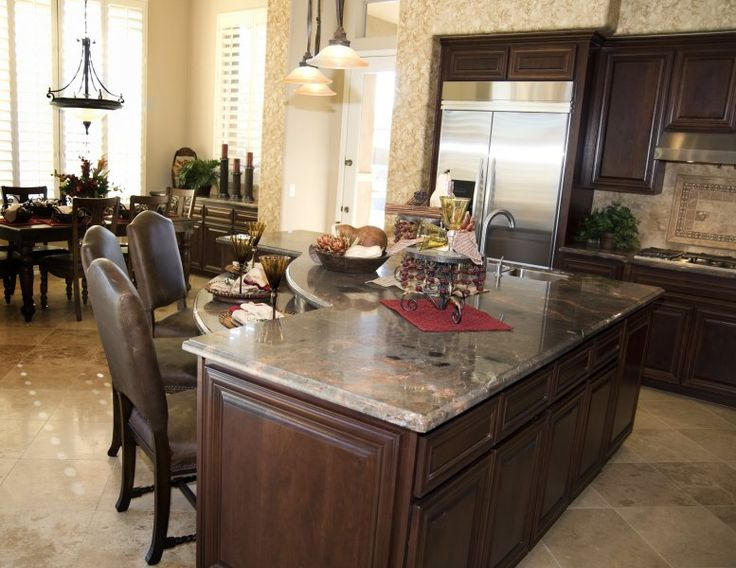 Dark Cabinets With Island Featuring Table Height Bar For Casual Eating. Walnut  Kitchen ...