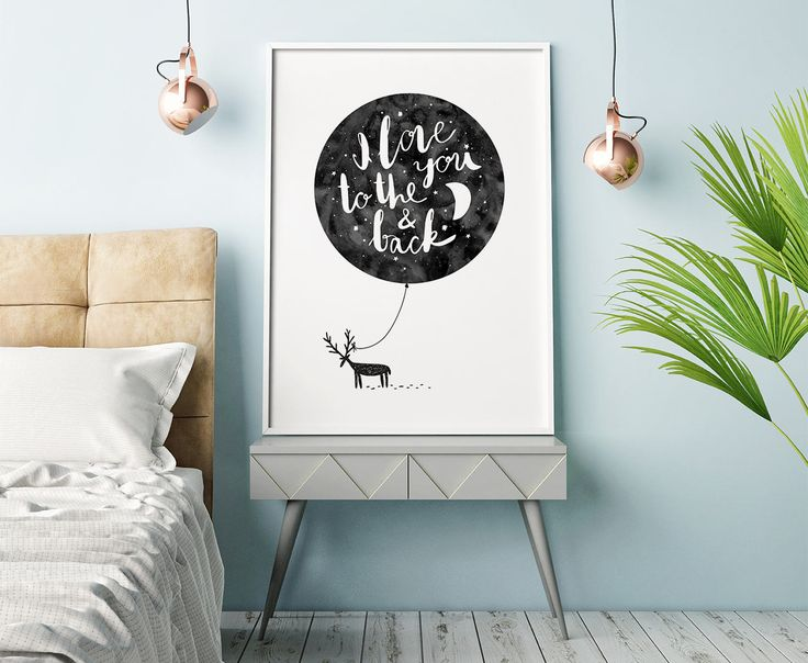 Cute children's poster with the text 'I love you to the moon and back'. A simple but adorable black and white poster for the children's room that goes well with many of our other prints. This is the perfect gift for a loved one in your life! Looks great in either a black or white frame.
