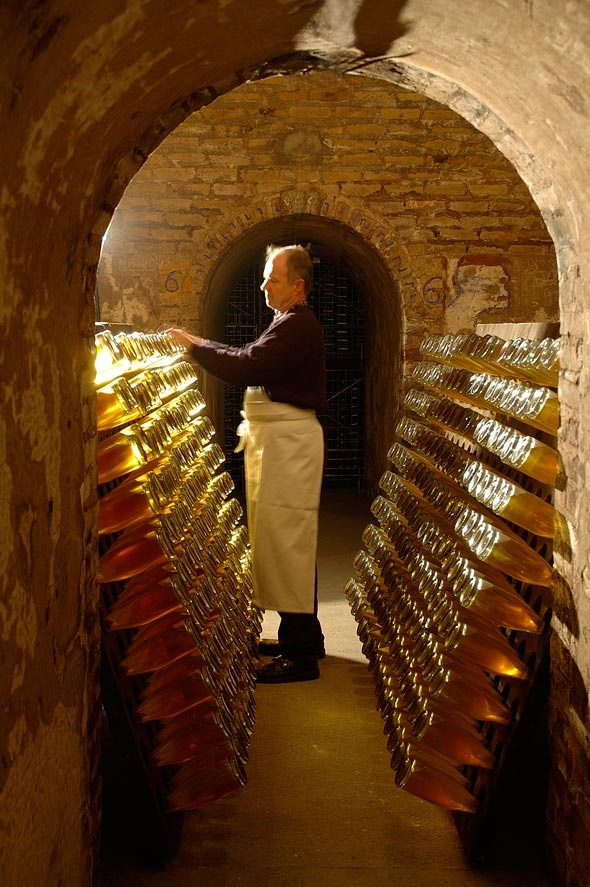 Riddling - (rolling bottles 45 degrees each day) cristal champagne | Cristal champagne cellar
