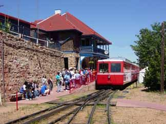Pikes Peak Cog Railway located in Manitou Springs, Colorado. Sit back and relax as the train ascends to over 16,000 feet to the top of Pikes Peak - America's Mountain.