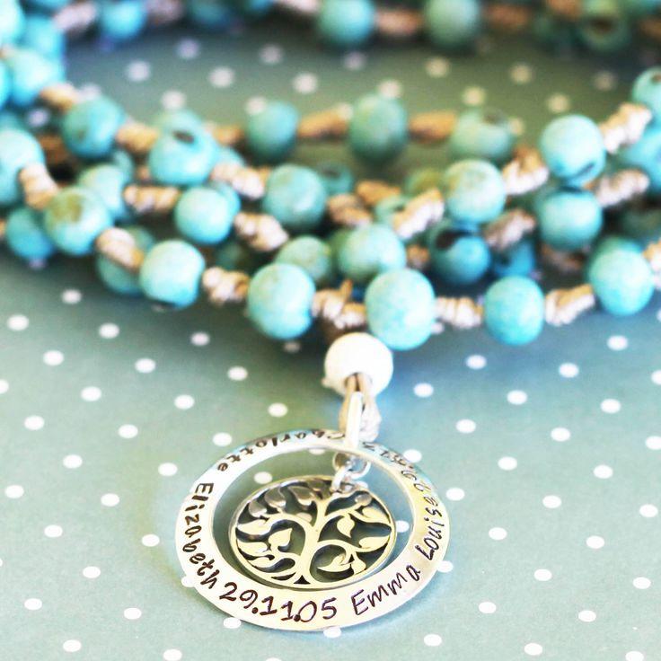 Knotted baby blue seed necklace with 1 washer tree of life
