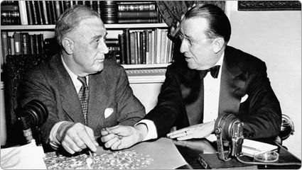 Franklin D. Roosevelt and Basil O'Connor count dimes at White House desk; 1944