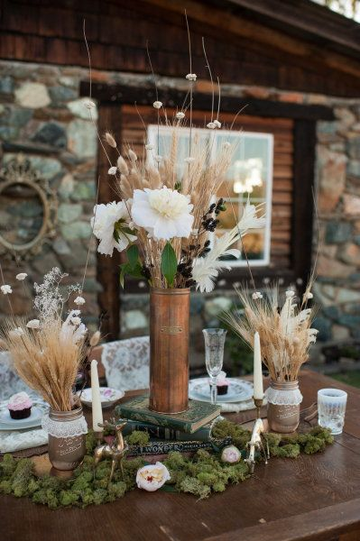 moss, gold painted mason jars with lace and wheat centerpieces, would be great for a fall wedding