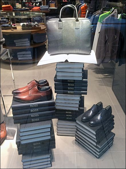 Simple Store Window that highlight your brand. Hugo Boss®, The Book  See how you can create simple but effective store Windows https://www.sishop.com.au/blog/retail-christmas-tips-attract-customer-with-effective-window-displays/