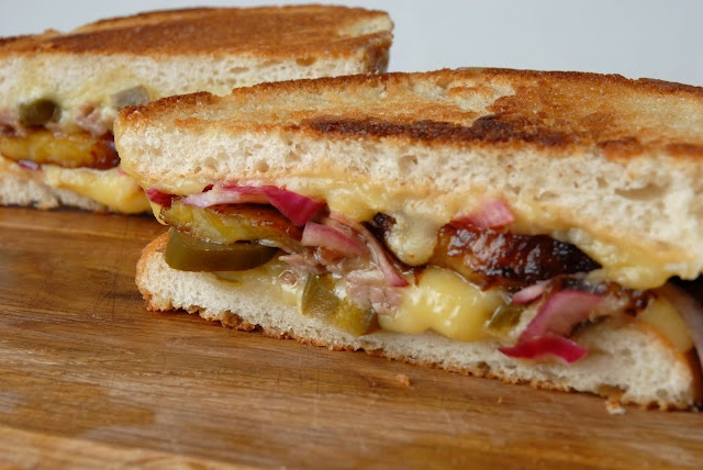 queso, pickled jalapenos, red onions, roasted pork, and plantains on ...