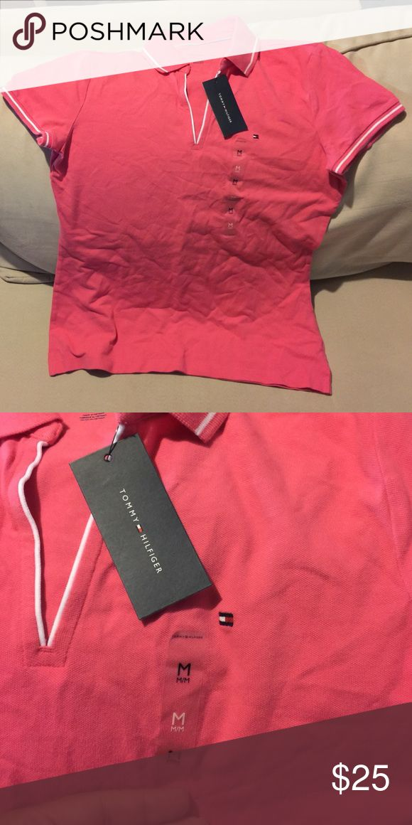 Pink TH ladies polo shirt Pink with a white line around the neck and sleeves. New with tags. Tommy Hilfiger Tops Blouses