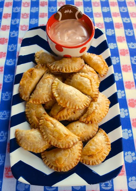 Buffalo Chicken Empanadas - buffalo chicken and cheddar baked in pie crusts - dip in some spicy ranch! These are SOOOO good!! They were the first thing to go at the party. Everyone raved about them!!