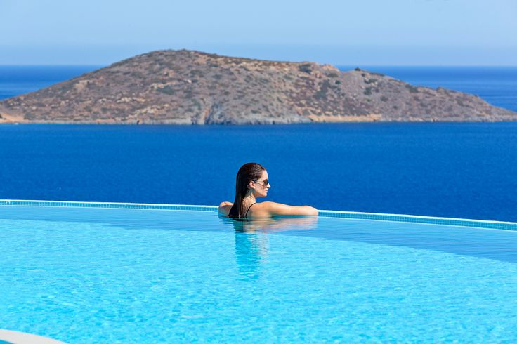 Above the sea...admiring the magnificent view at #EloundaGulfVIlas & Suites infinity pool!