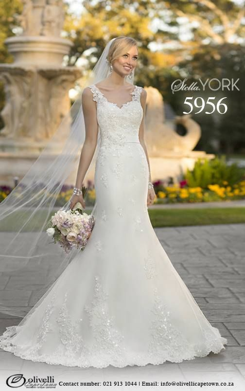 The gorgeous Stella York, style 5956 lace over French Mikado dress is a lovely trumpet silhouette that will make you feel sexy and super slim. This designer wedding gown will hug your frame down through the hips before it gracefully flares out to the hem. Hand-sewn Diamante beading together with the lace cap sleeves and impeccable attention to detail will make you husband-to-be's heart melt as you walk down the aisle. #StellaYork #OlivelliCT #Wedding #Gown #Dress