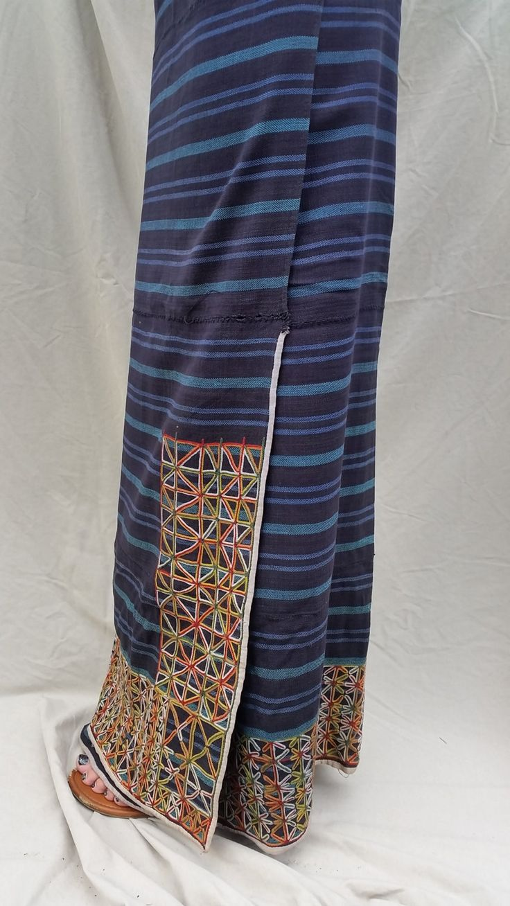 WODAABE: Wrap skirt Embroidered on hand-woven indigo