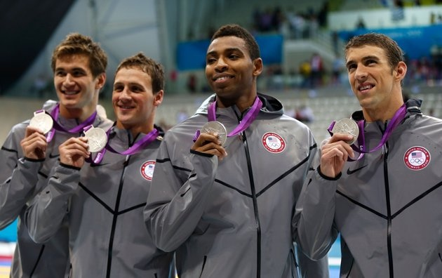 (L-R) Adrian Nathan, Ryan Lochte, Cullen Jones and Michael Phelps of the United States pose with the silver medals won during the Men's 4 x 100m Freestyle Relay final on Day 2 of the London 2012 Olympic Games at the Aquatics Centre on July 29, 2012 in London, England.