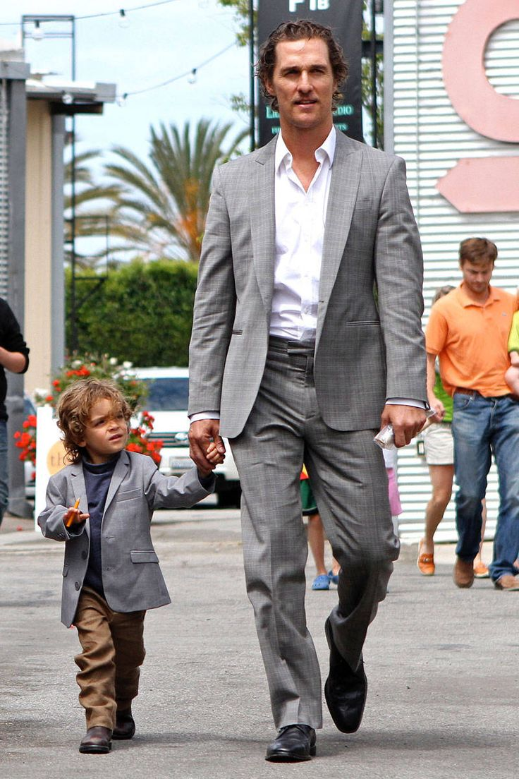 Matthew McConaughey with his son in very close to matching suits. It's his mini-me!